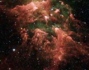 Preciosa foto en infrarrojo del telescopio espacial Spitzer de una región de intensa formación estelar llamada Eta Carinae.