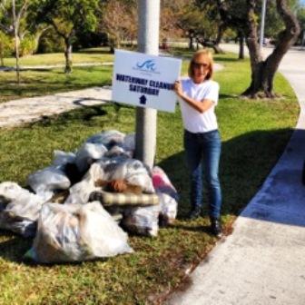 Raiza Perrault colaborando en su comunidad