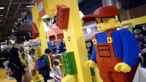 People walk into the Lego stand at the Kidexpo exhibition in Paris on October 24, 2014. The exhibition, which features ideas and solutions for parents and shows, discovery spaces and workshops for kids, runs from October 23-27. AFP PHOTO / STEPHANE DE SAKUTIN
